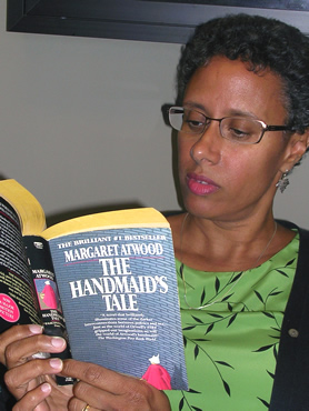 "Librarian reading ""The Handmaid's Tale,"" a banned book"